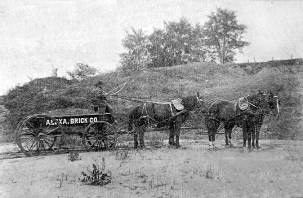 This photograph may be the only extant image of Freedmen�s Cemetery. Taken in 1899, it depicts an Alexandria Brick Company wagon. Freedmen�s Cemetery is atop the hill in the background. The brick manufacturer was located to the southwest of the cemetery, and removed clay from the west slope of the hill, reportedly exposing some graves in the early 1890s.